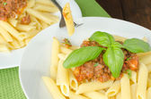Penne with bolognese sauce — Stockfoto