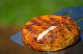 Camembert on grill — Stock Photo
