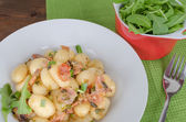 Schwarzwald gnocchi with ham, onion and wine — Stock Photo