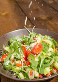 Arugula Salad with tomatoes, olives and parmesan — Stock Photo