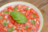 Tomato salad with onion and basil — Stock Photo