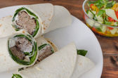 Wrap with pork meal, creame and romaine lettuce — Stock Photo