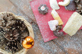 Christmas candy with pinecone in punnet — Stock Photo