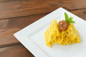 Penne Bolognese on wood table — ストック写真