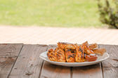 Chicken wings on grill — Stock Photo