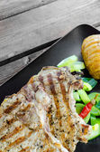 Grilled cutlet with vegetables and roasted potatoes — Stock Photo