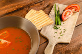 Tomato soup with toast and chive — Stock Photo