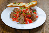 Meatballs with spicy tomato salsa — Stock Photo