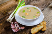 Soup garlic with toasted croutons — Stock Photo