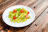 Rigatoni pasta with genoese pesto and sherry tomato — Stock Photo