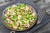Fried mushrooms with spring onion on pan — Stock Photo