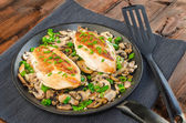 Chicken breast with mushrooms and spring onions on pan — Stock Photo