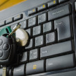 Keyboard with CD and keys from car — Stock Photo #51306963