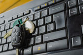 Keyboard with CD and keys from car — Stock Photo