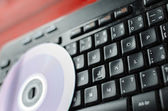 Keyboard with CD — Stock Photo