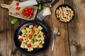 Home made ravioli with basil pesto — Stock Photo