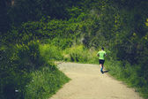 Young athlete running hard up the hill — Stock Photo