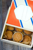 Muffins in a wood box — Stock Photo