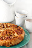 Estonian cake called pidusai filled with apples, cinnamon, sugar and raisin, cup with chocolate drink — Stock Photo