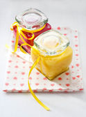 Jars with homemade fruit curd with tags on the jars — Stock Photo