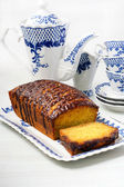 Jaffa drizzle loaf. Orange cake with chocolate glaze — Stock Photo