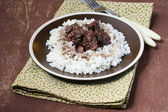 Beef stewed in red wine and rice — Stock Photo