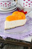 Quark cheese cake with tangerine decoration — Stock Photo