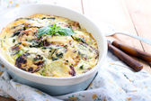 Courgette and herb gratin — Stock Photo