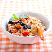 Rice with sauteed vegetables in tomato sauce — Stock Photo