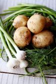 Potatoes,young garlic, green, isolated, — Stock Photo