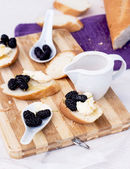 Snack on french baguette on a wooden board — Stok fotoğraf