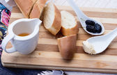Appetizer baguette on a wooden board — Stock Photo