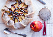 Baked biscuits with peach and blueberry on a white table — Стоковое фото