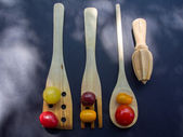 Clolrful Tomatoes and Wooden Instrument — Stock Photo