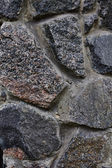 Texture of a stone fence made with  brickwork rocks — Stock Photo