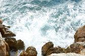 Sea rocks in waves — Stock Photo