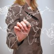 Hand of business man write world map on tablet pc touch screen — Stock Photo #49400083