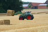 Tractor with bales of straw — Stock Photo