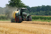 Tractor with straw baler — Stock Photo