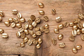 Golden beans of coffee — Stockfoto