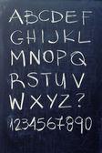 Alphabet on blackboard — Stockfoto