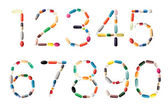 Numbers with pills — Stock Photo