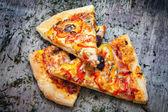 Pizza cut into slices — Zdjęcie stockowe