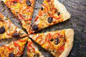 Pizza cut into slices  — Stock Photo