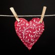 Red heart hanging on the clothesline — Stock Photo #49787853