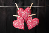 Red hearts hanging on the clothesline — Stock Photo