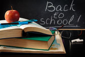 School supplies against blackboard. — Stock Photo