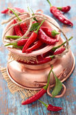 Chili peppers in copper pot. — Stock Photo