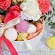 Colored marshmallows, macaroon and a bouquet of flowers — Stock Photo #49814883