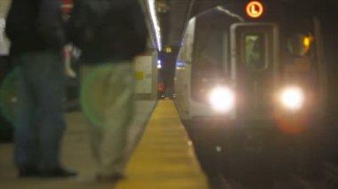 Train arriving at platform — Stockvideo